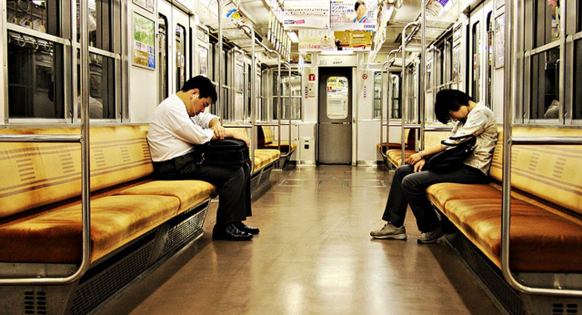 Two men asleep on the train