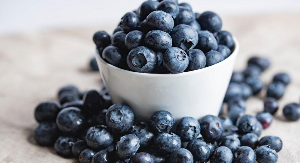 Blueberries overflowing a bowl