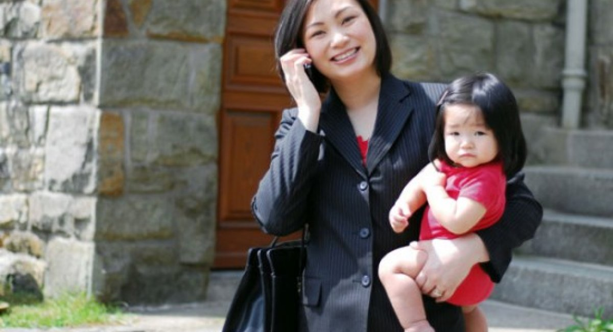 Japanese Working Mother With Child
